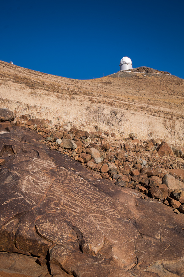 Group A petroglyphs with 3.6m telescope in the background - La Silla Observatory - Chile