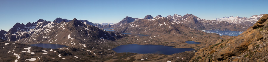 Panorama of lakes, the Flower Valley and the Tasiilaq Fjord from most of the way up Qaqqartivakajik mountain, East Greenland