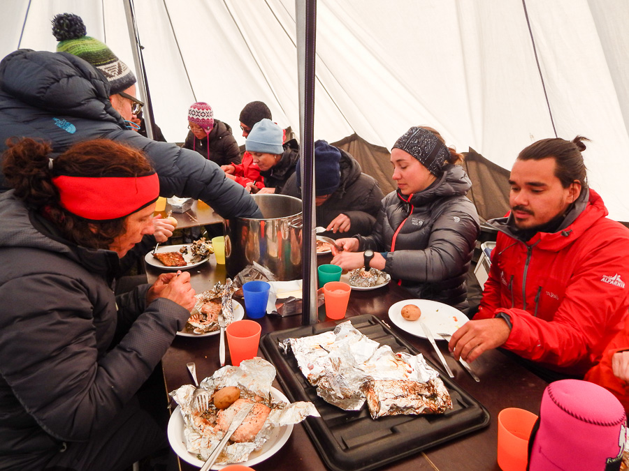 My trekking companions and I eating dinner in the cook/dining tent on the first day of Unplugged Wilderness