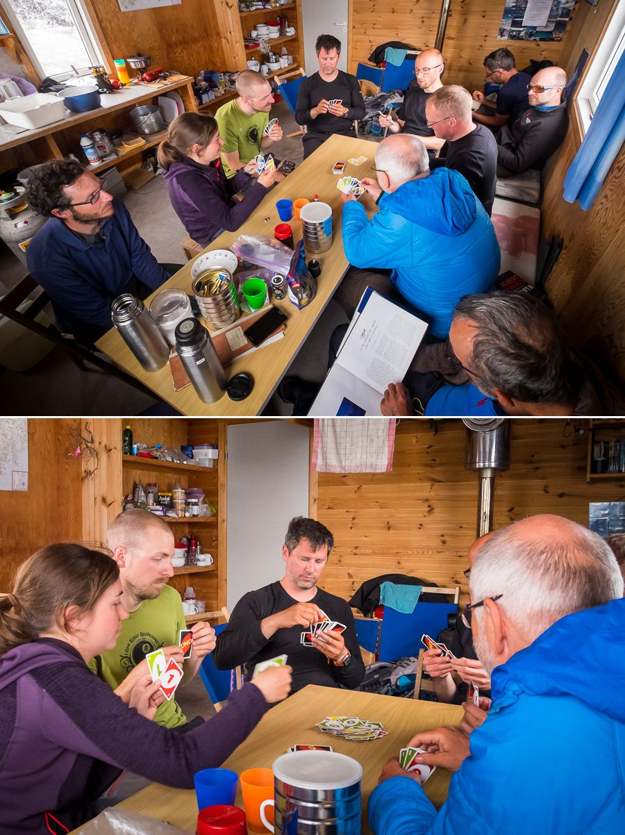 Several of the group playing UNO around the dining table at the Tasiilaq Mountain Hut