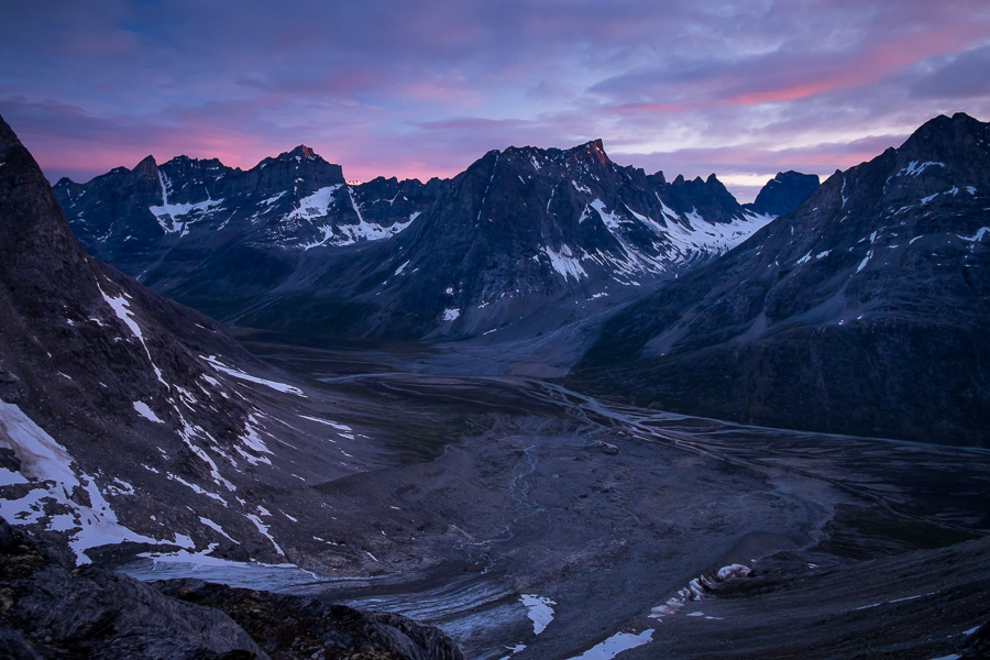 Clouds highlighted in pink as the Sun sets over the Tasiilap Kua valley - as seen from the Tasiilaq Mountain Hut