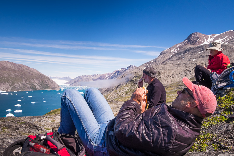 Friends hanging out and admiring the Qooroq Glacier at the viewpoint of the Lake and Plateau Hike near Igaliku in South Greenland