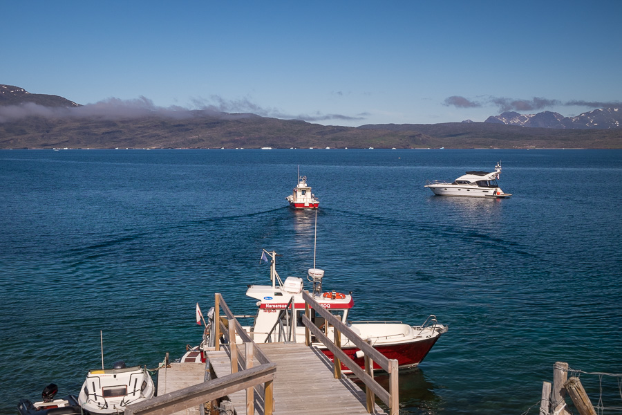 The dock at Itilleq which provides access to Igaliku. Two of the red and white Blue Ice transfer boats are visible as is a private yacht