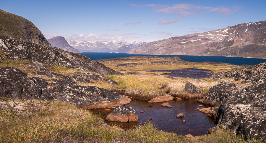 Small tarns and a view up the Fjord towards Narsarsuaq. Seen from near Narsaq, South Greenland