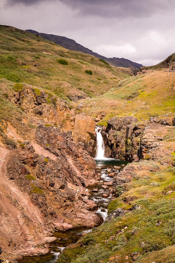 A small waterfall. Hiking through the Qorlortup Itinnera valley near Qassiarsuk, South Greenland