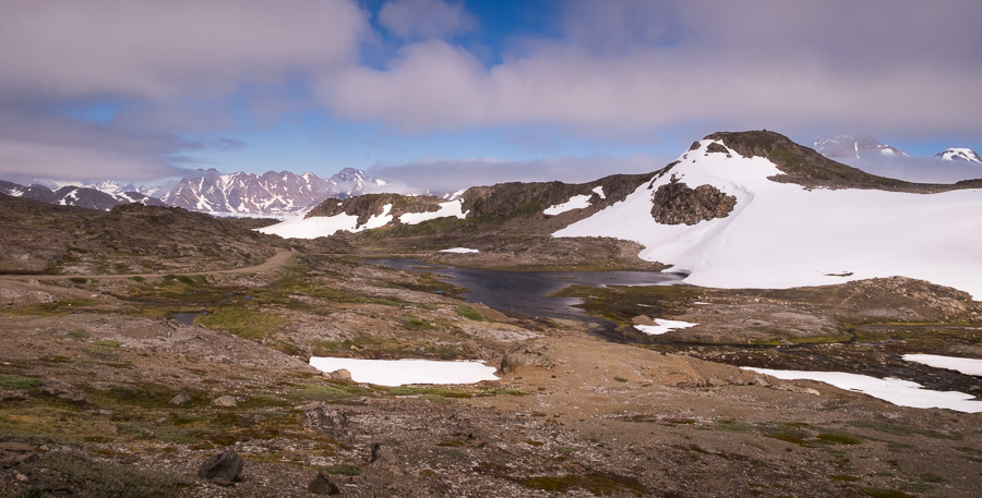 Small lake and general landscape. Seen while hiking from Kulusuk to Isikajia, East Greenland