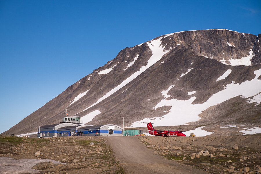 Looking along the road towards the Kulusuk airport terminal, with an Air Greenland plane parked.