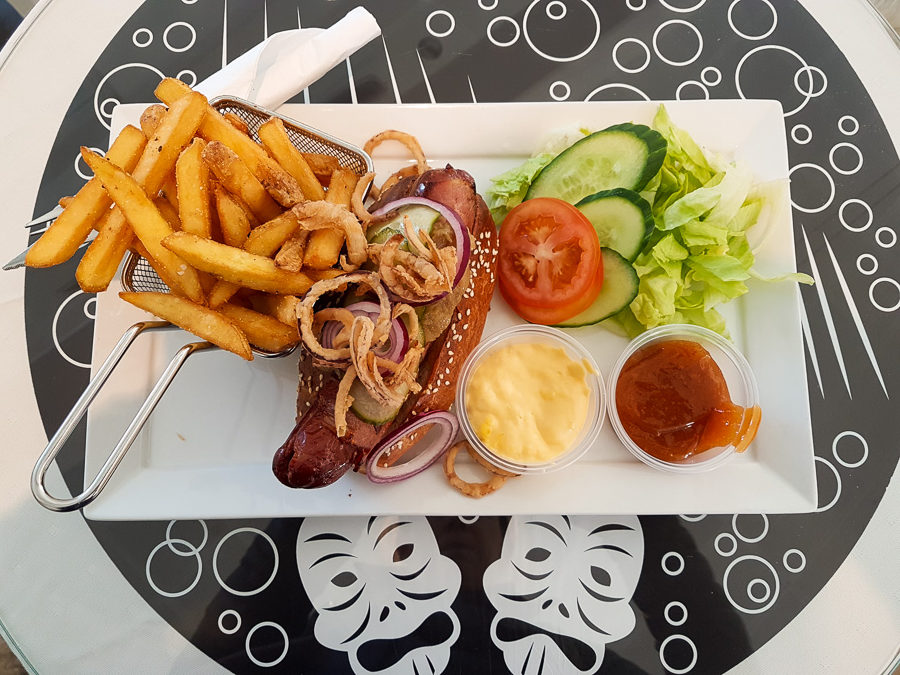Musk Ox Hotdog with chips and salad at the Katuaq Cultural Centre in Nuuk, Greenland