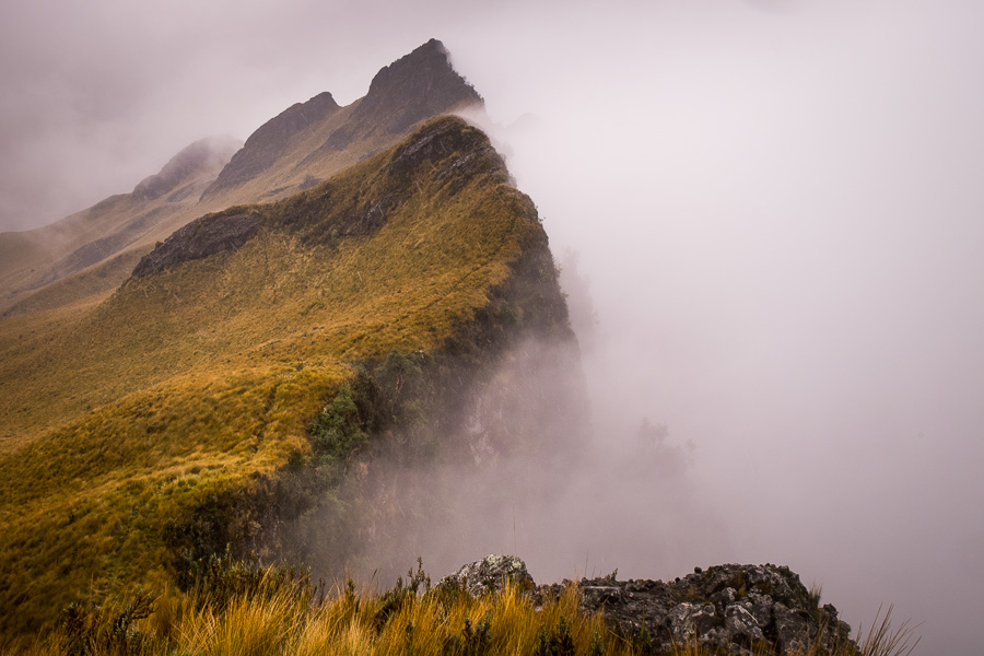 Crater ridge and crater filled with fog, while hiking to the summit of Volcán Pasochoa near Quito, Ecuador