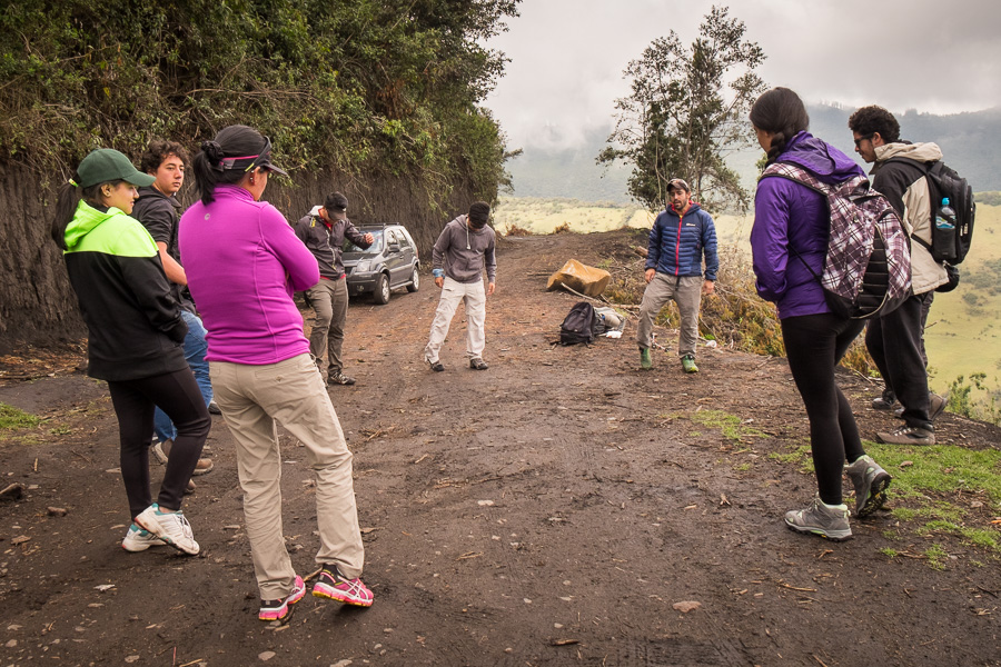 Hiking companions warming up before starting along the trail to Volcán Pasochoa near Quito, Ecuador