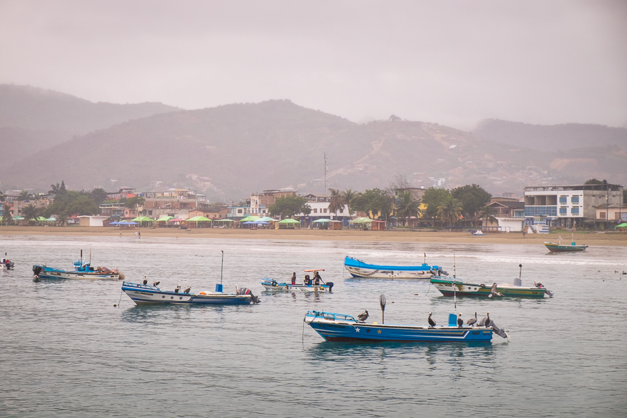 The beach and town of Puerto Lopez behind the fishing boats that sustain the community for most of the year