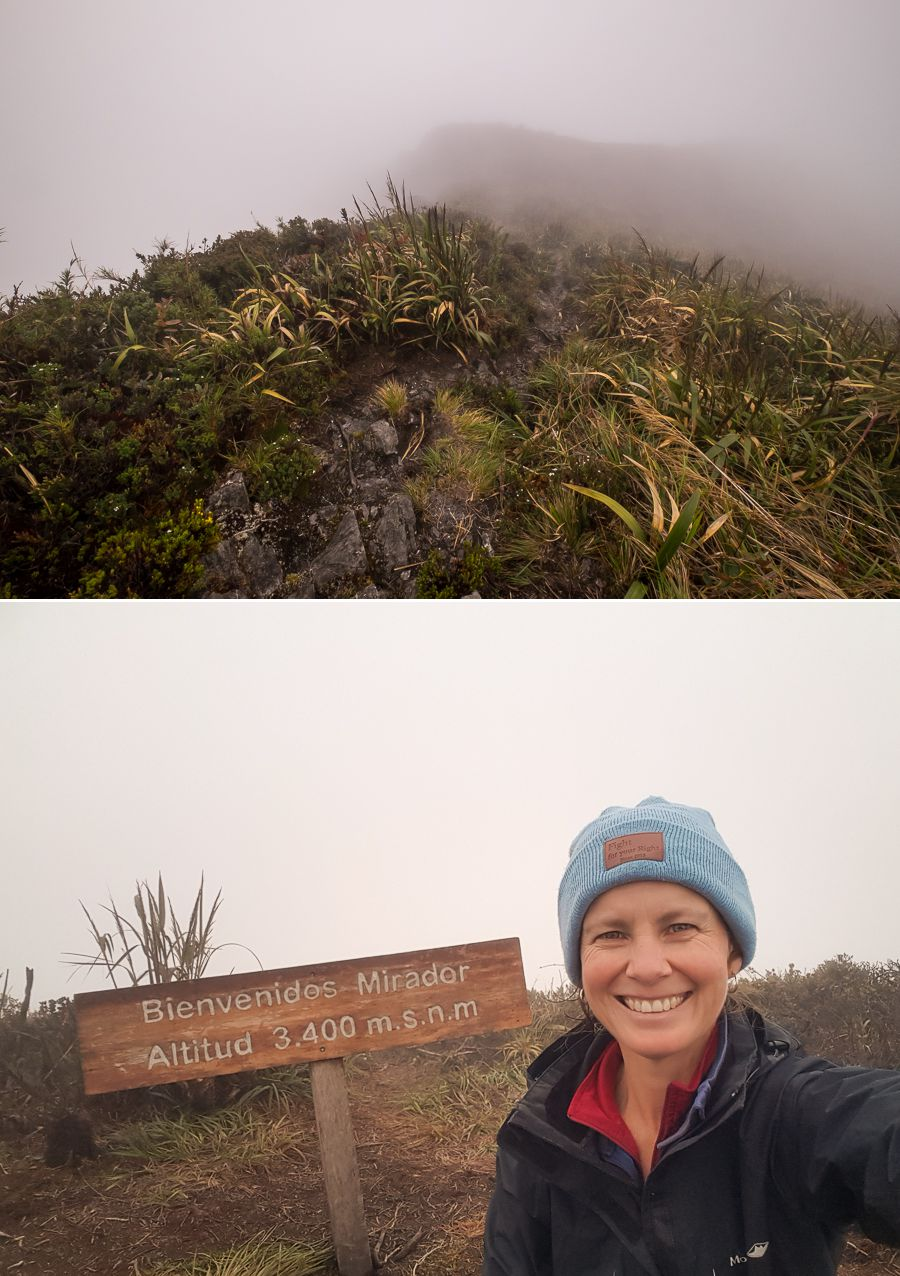 Me at the sign indicating the highest point of Los Miradores hike in Podocarpus National Park near Loja, Ecuador