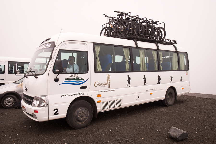 The CarpeDM minibus with mountain bikes loaded for the Cotopaxi day tour in Ecuador